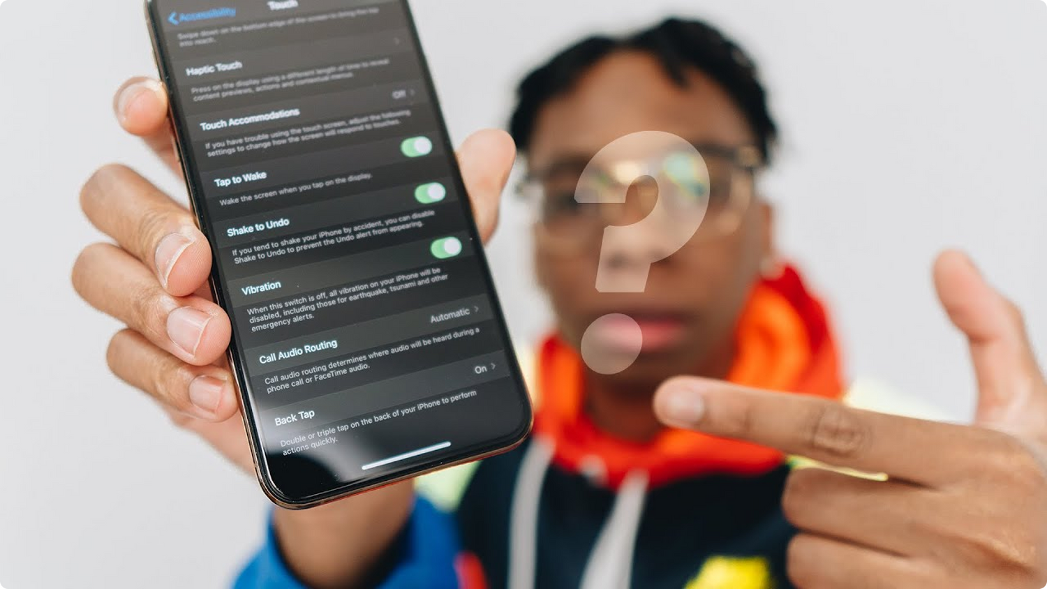 Shevon Salmon pointing to the Back Tap iOS 14 feature
